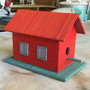 Combed bird house
