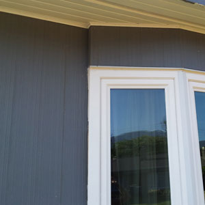 Exterior wooden combed siding